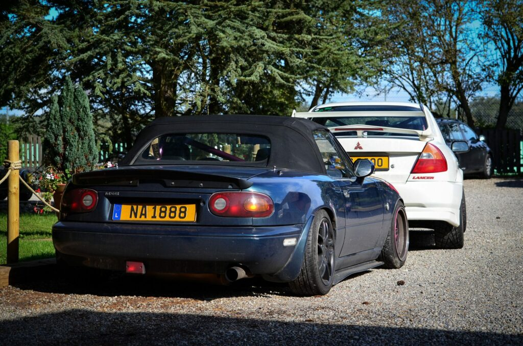 Street driven Mazda MX-5 with a roll bar