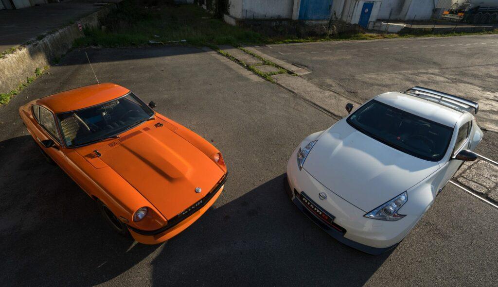Z car history: a Datsun 240z next to a Nissan 370z