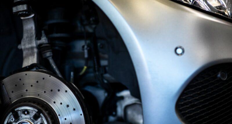 Adjusting wheel caster angle